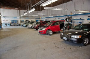 The open service bay lined with cars neeing auto body repair at Langley On Line Collision.