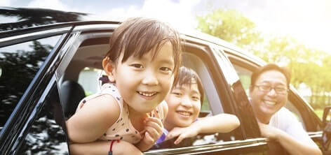 A happy family in a car they just had repaired at on line collision a I-CAR gold certified repair center.