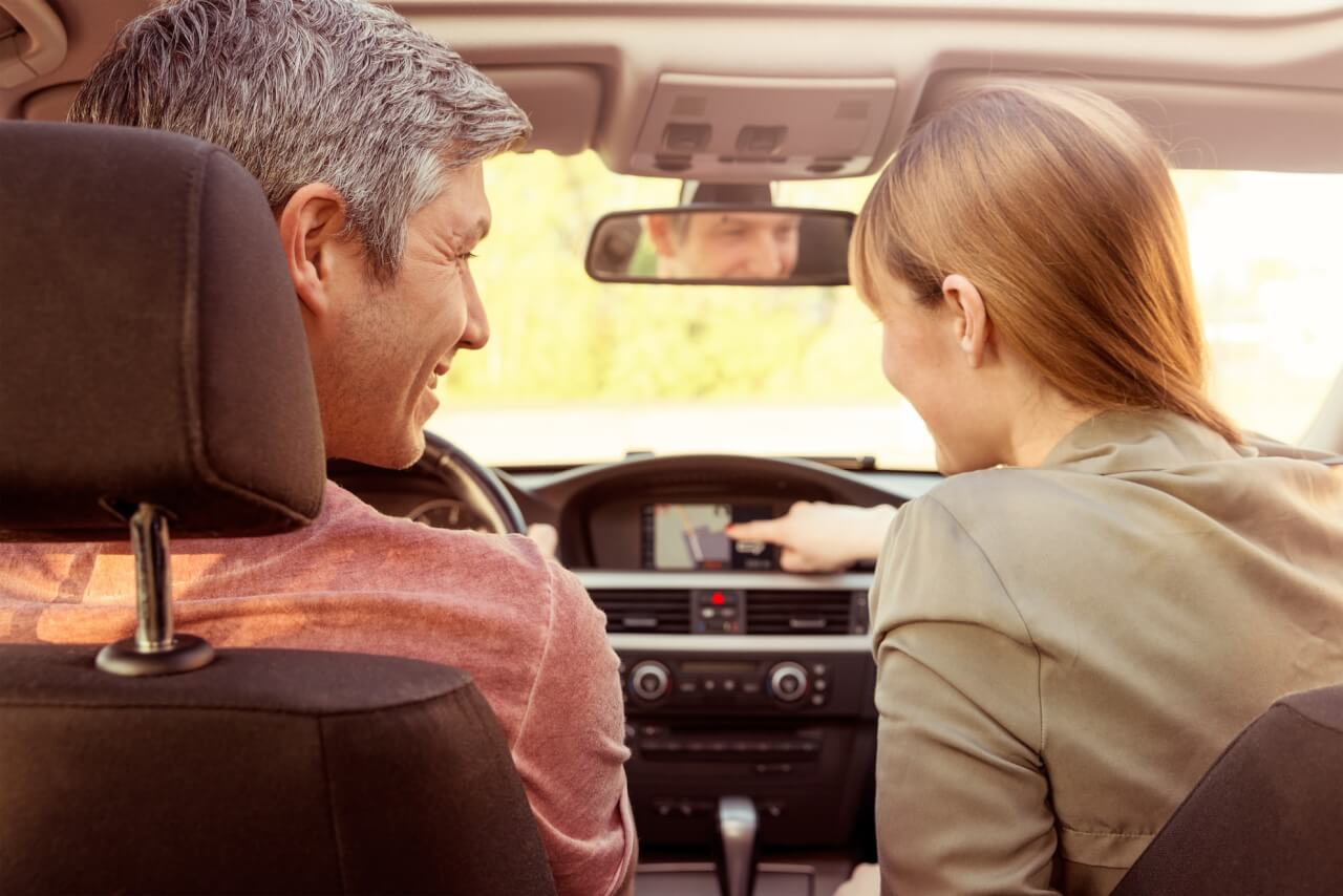Car tips on line collision Langley