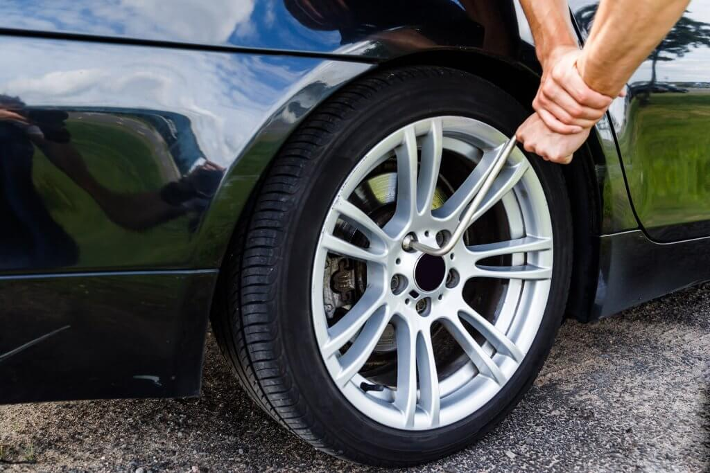 Changing Tire - Auto Body Repair Langley - On Line Collision