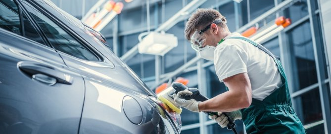 man fixing car at ICBC collision auto body repair Langley - On Line Collision