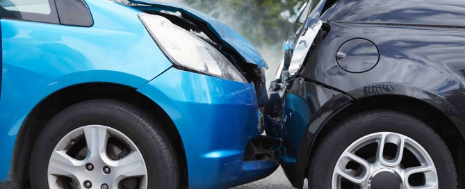 Two cars in need of collision repairs