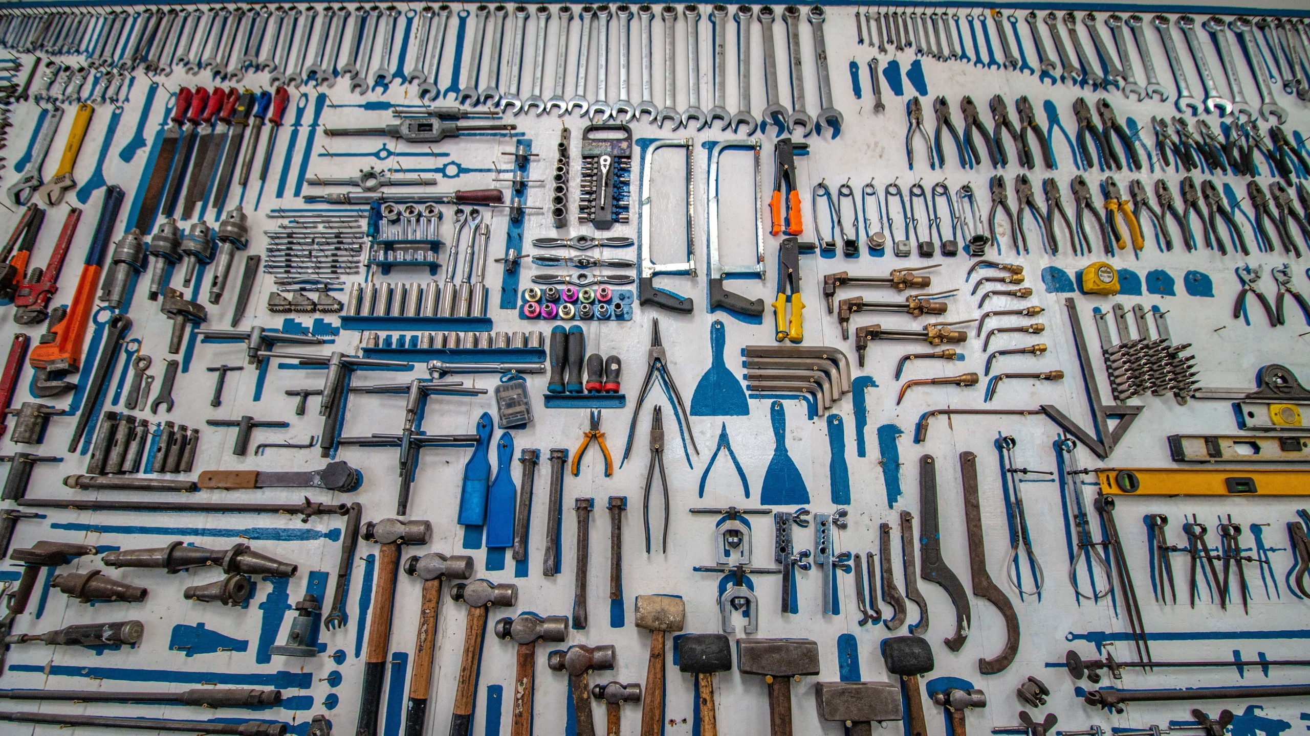 car tools layout on a white wall